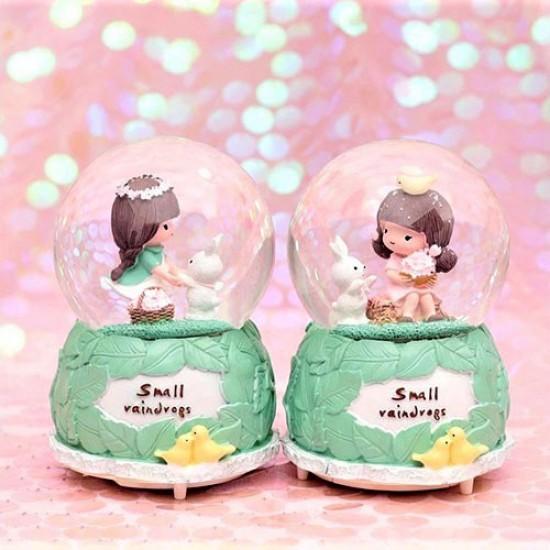 Sevemli Kız ve Tavşanlı Kar Küresi